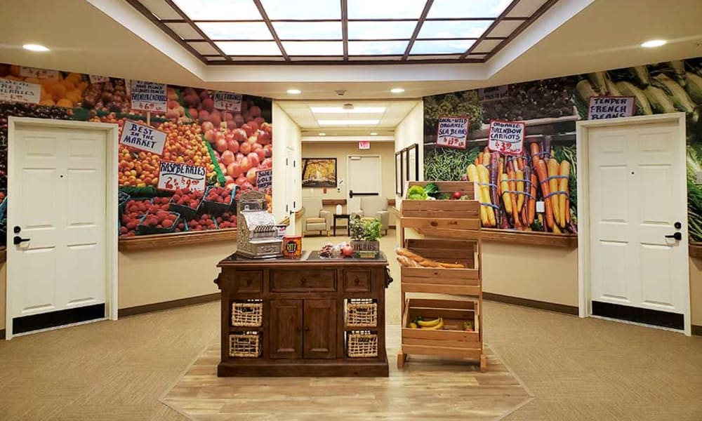 Produce station in a hallway at Quail Park Memory Care Residences of West Seattle in Seattle, Washington