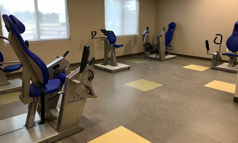Assisted walking machines in the gym at Quail Park of Lynnwood in Lynnwood, Washington