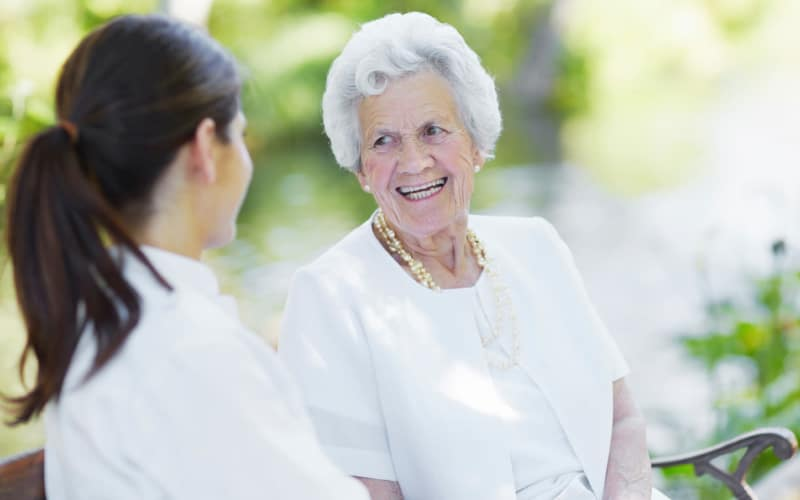 Senior living resident and staff member chatting at Moran Manor in Moran, Kansas