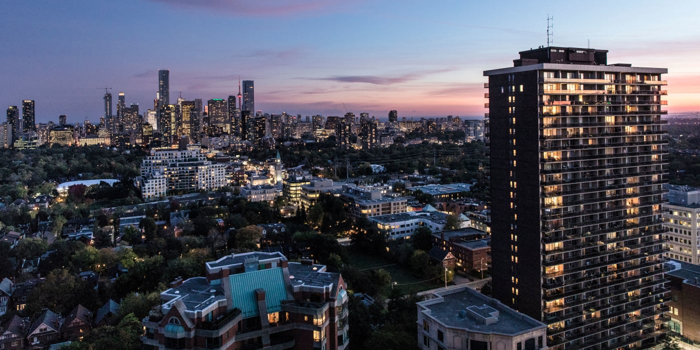 Aerial view at dusk of Bretton Place apartments