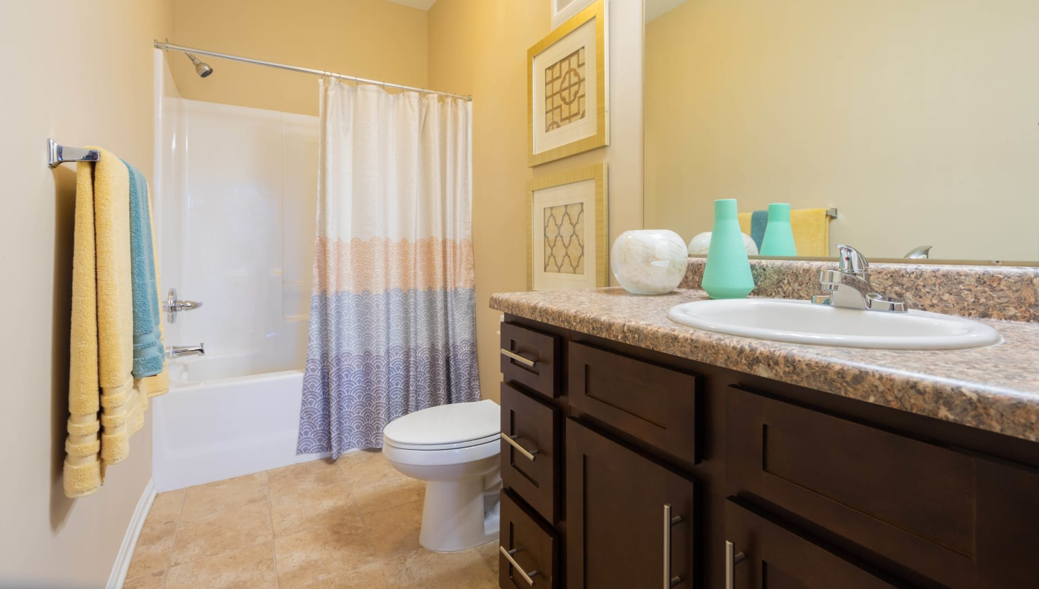 Spacious master bathroom with a tiled shower in a model home at Legends at White Oak in Ooltewah, Tennessee