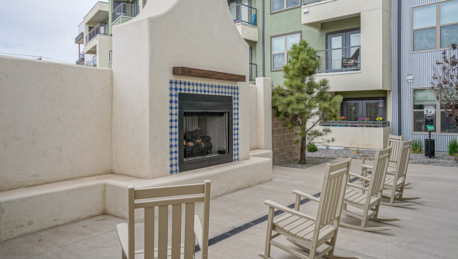 Patio seating with fireplace at Capitol Flats in Santa Fe, New Mexico