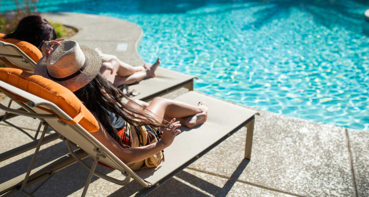 Residents lounging by the poolside at Borrego at Spectrum in Gilbert, Arizona