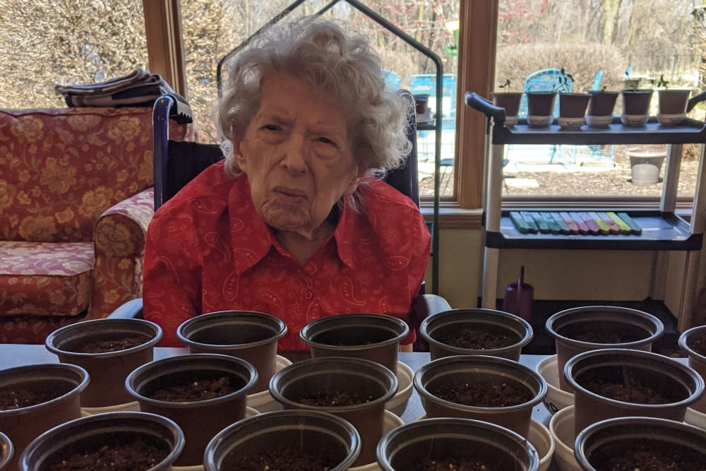 Resident working with flower pots at Ramsey Woods in Cudahy, Wisconsin.