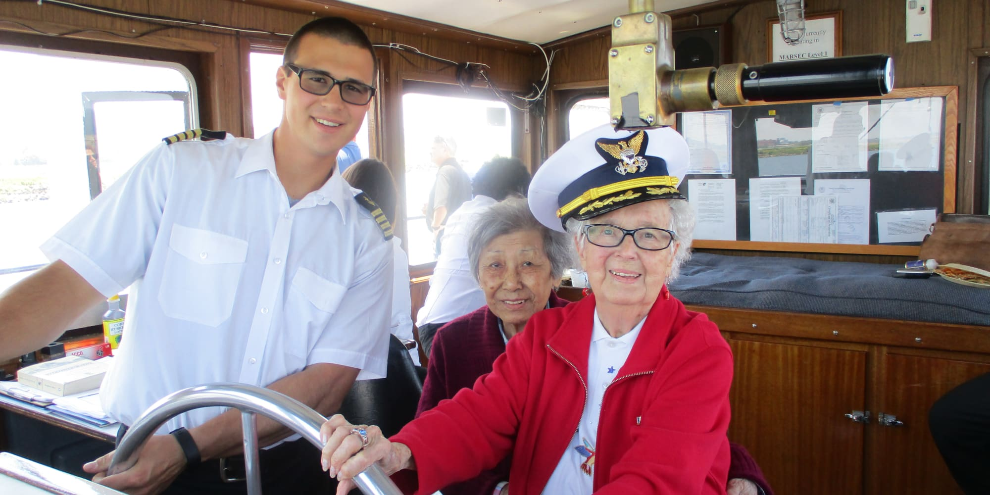 A resident from Mulberry Gardens Assisted Living in Munroe Falls, Ohio steering a boat