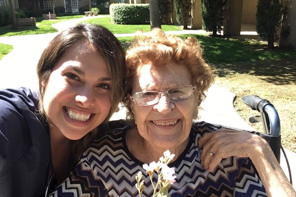 Resident taking a selfie with a caretaker at Quail Park on Cypress in Visalia, California