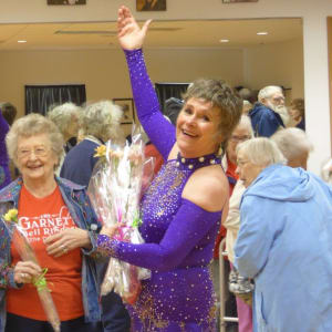 Resident Elayne performs for her Dare to Dream event at Garnett Place in Cedar Rapids, Iowa