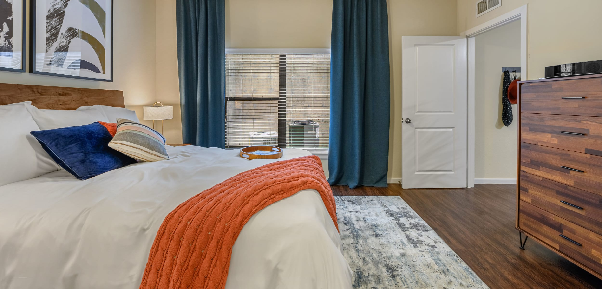 Bedroom with wood style floors at Marquis SoCo in Austin, Texas