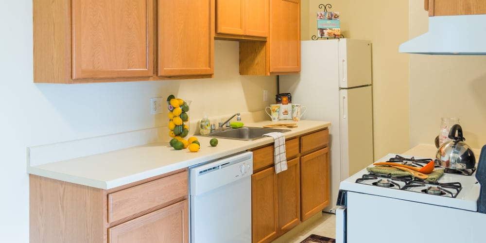 Kitchen amenities at Maple Grove Apartments in Sterling Heights, Michigan
