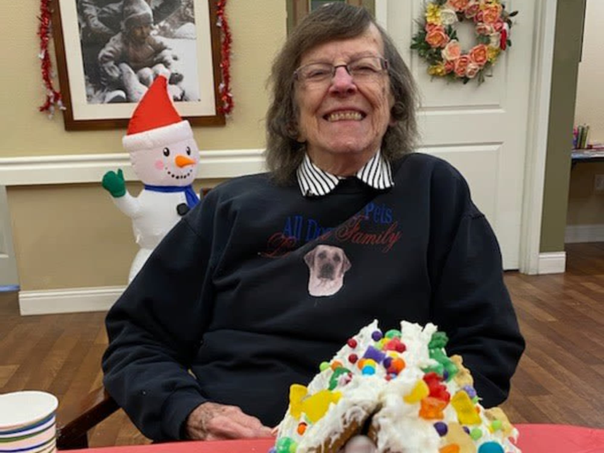Decorating ginger bread houses at Seven Lakes Memory Care in Loveland, Colorado