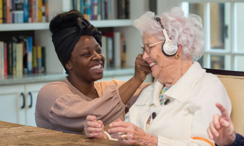 Resident listening to music at a Maplewood Senior Living community