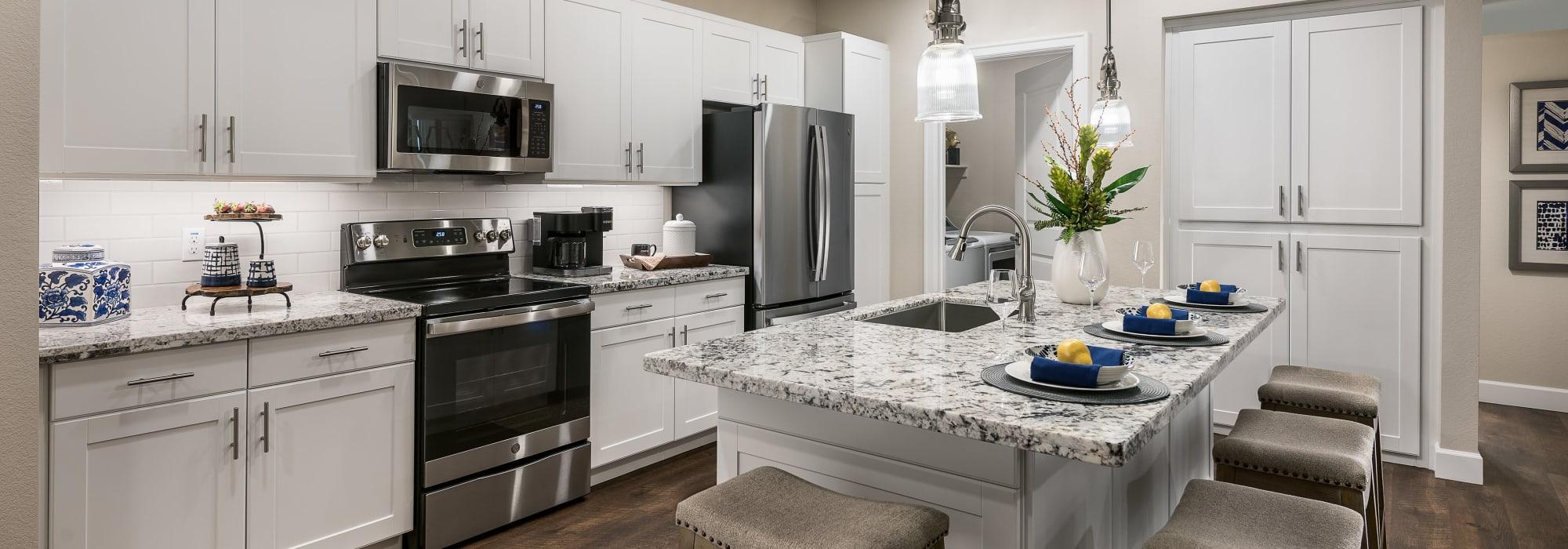 Modern kitchen with stainless steel appliances at San Artes in Scottsdale, Arizona