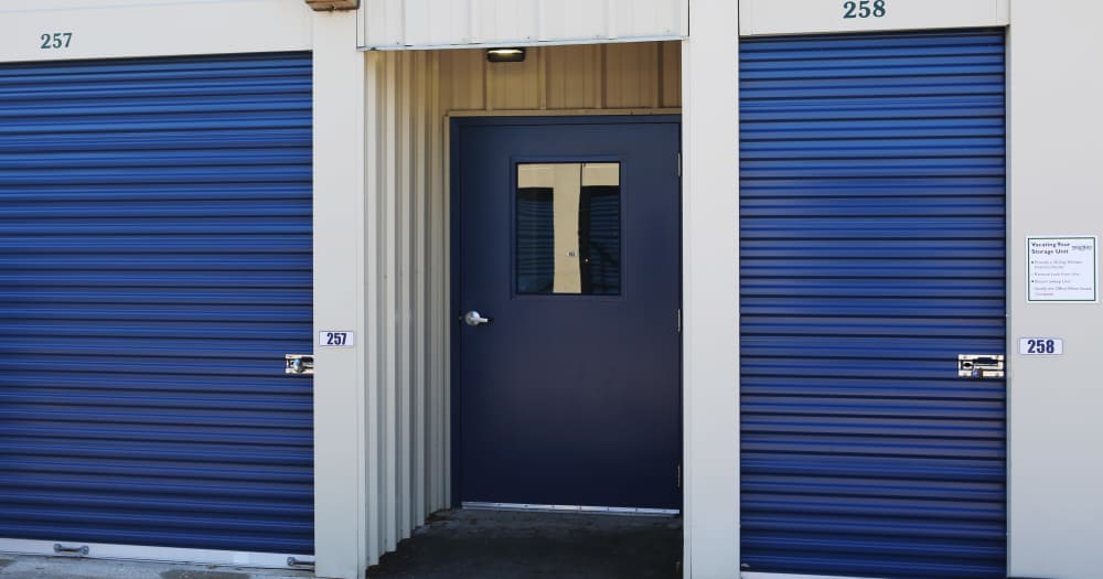 Storage units with blue doors at Midgard Self Storage in Newberry, Florida