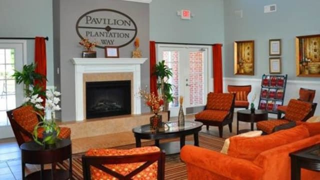 Community room with fireplace at Pavilion at Plantation Way