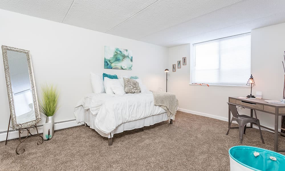 Bedroom at Racquet Club Apartments in Rochester, New York