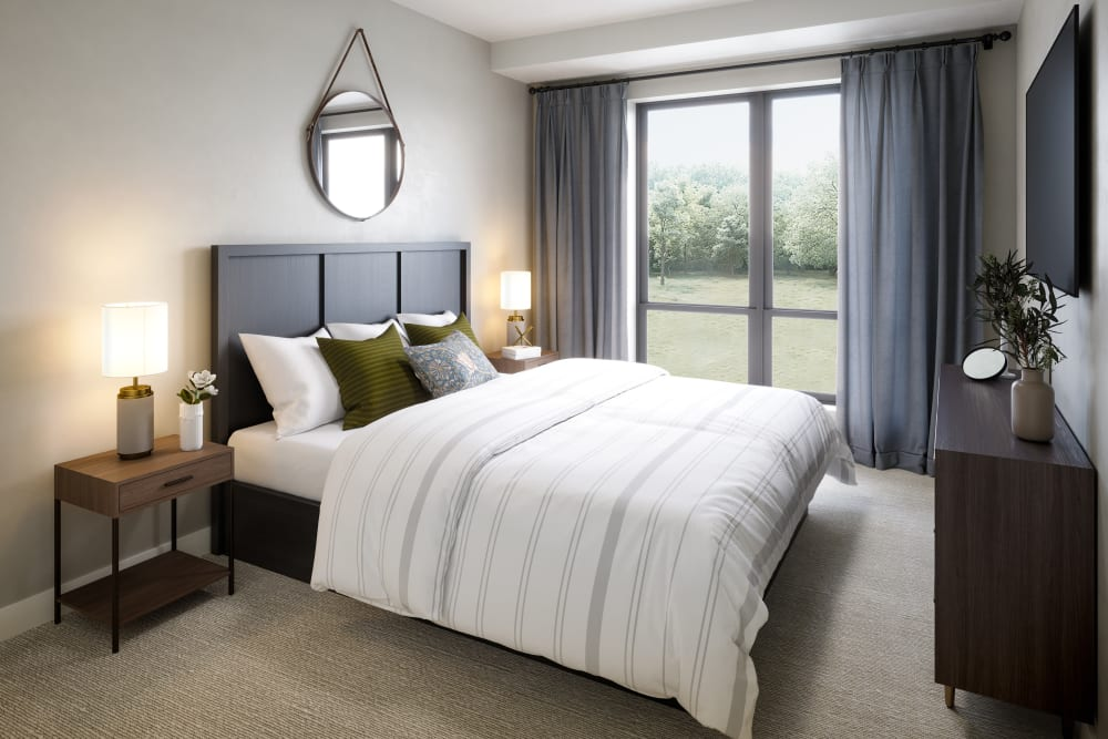 Bedroom in a senior apartment with a door that leads outside at Amira Minnetonka in Minnetonka, Minnesota