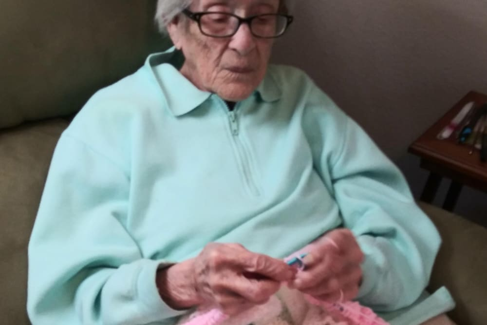 Resident knitting at Arlington Place of Red Oak in Red Oak, Iowa