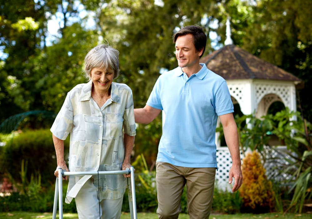 Resident and son walking at Ramsey Village Continuing Care in Des Moines, Iowa