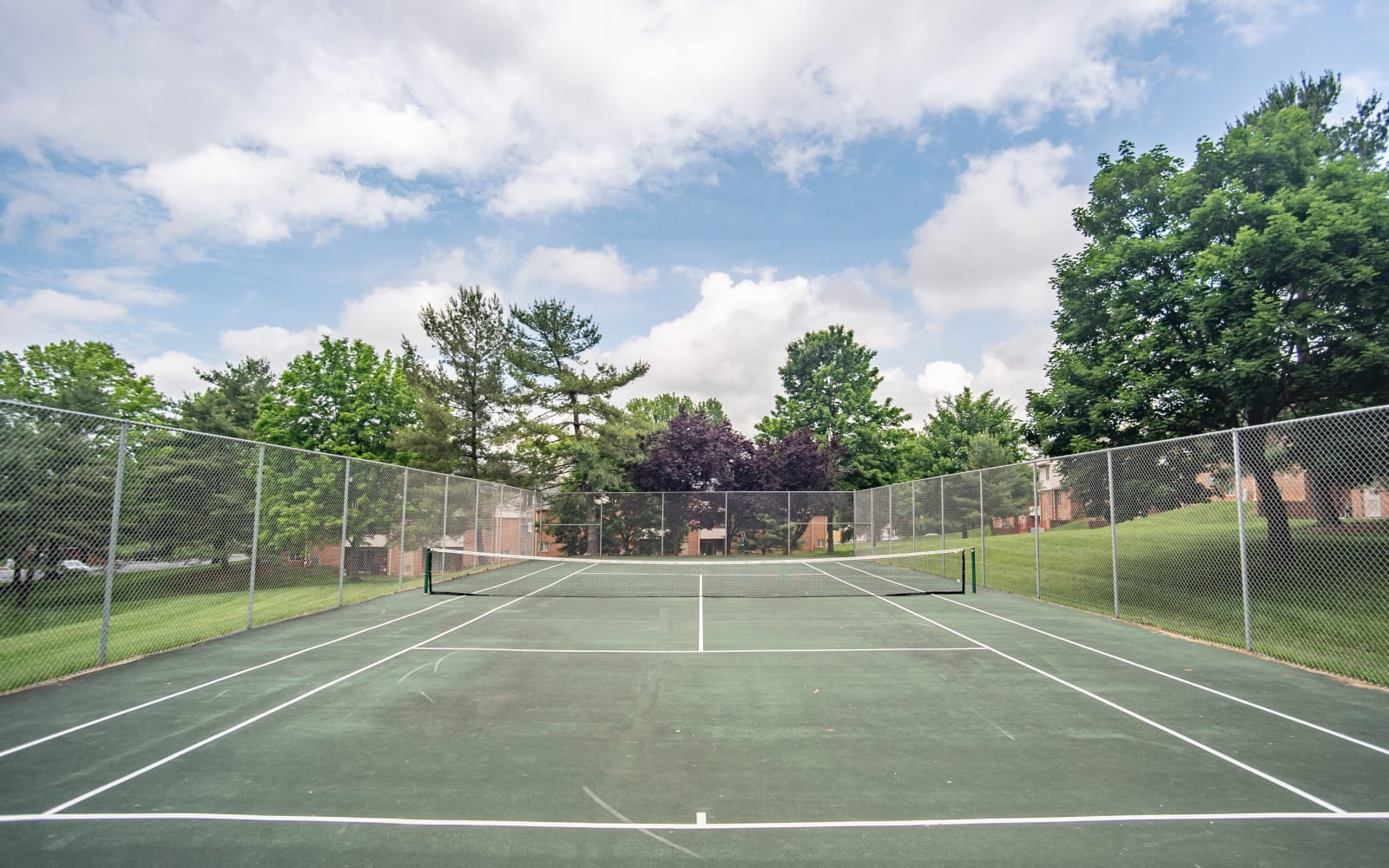 On-site tennis court at Hunt Club Apartments in Cockeysville, Maryland