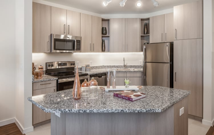 Beautiful gourmet kitchen with granite countertops in a model resident home at All Seasons Ann Arbor in Ann Arbor, Michigan