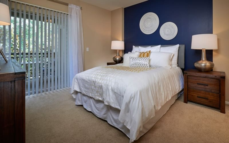 Master bedroom with plush carpeting at Legend Oaks Apartments in Aurora,