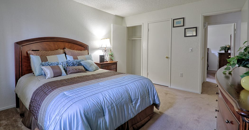Large bedroom in model apartment home at Country Hills Apartment Homes