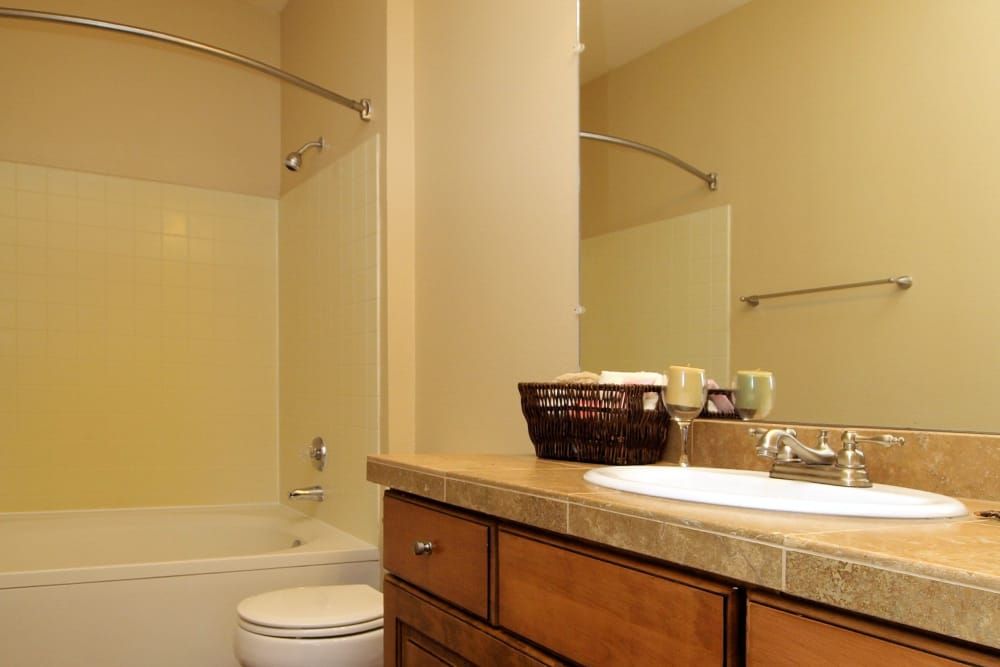 Well lit model bathroom at Cortland Village Apartment Homes in Hillsboro, Oregon