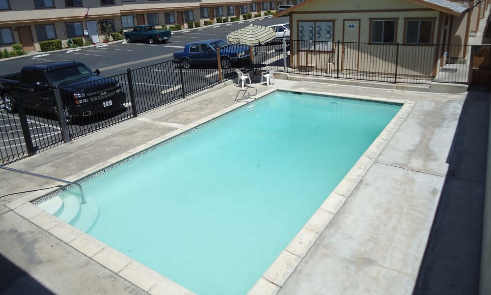 Aerial view of the swimming pool area at Olympus Court Apartments in Bakersfield, California