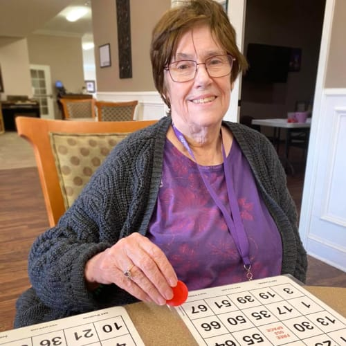 Smiling resident playing Bingo at FountainBrook in Midwest City, Oklahoma