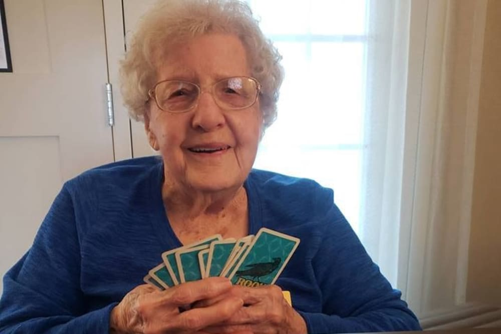Senior resident playing with cards at Homewood Health Campus in Lebanon, Indiana