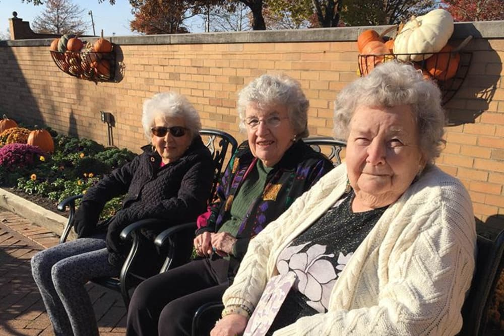 A group of residents sitting in the backyard at Morrison Woods Health Campus in Muncie, Indiana