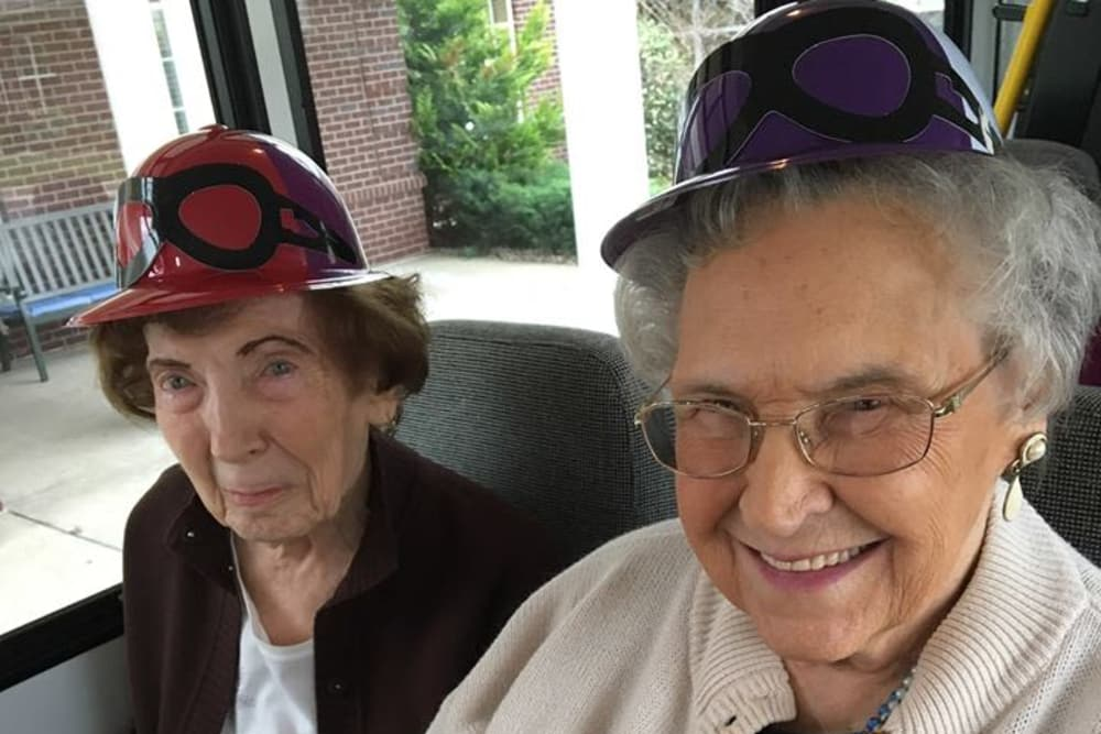 Residents wearing hats on the community bus at The Willows at Hamburg in Lexington, Kentucky