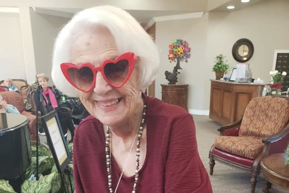 A resident with fun heart sunglasses on at Pelican Bay in Beaumont, Texas