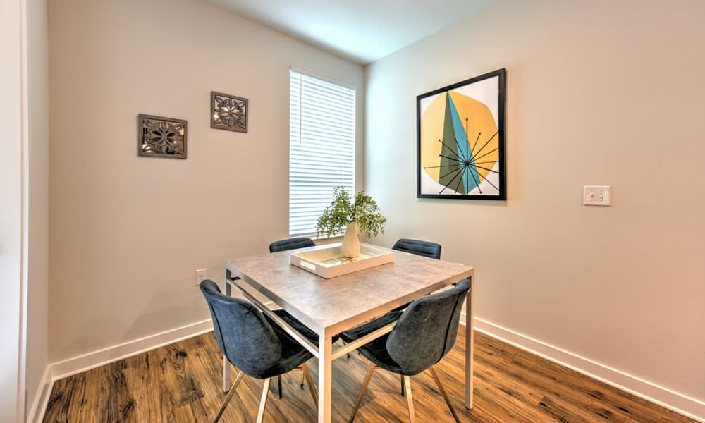 Dining space with wood floor at Fusion apartments in Jacksonville, Florida