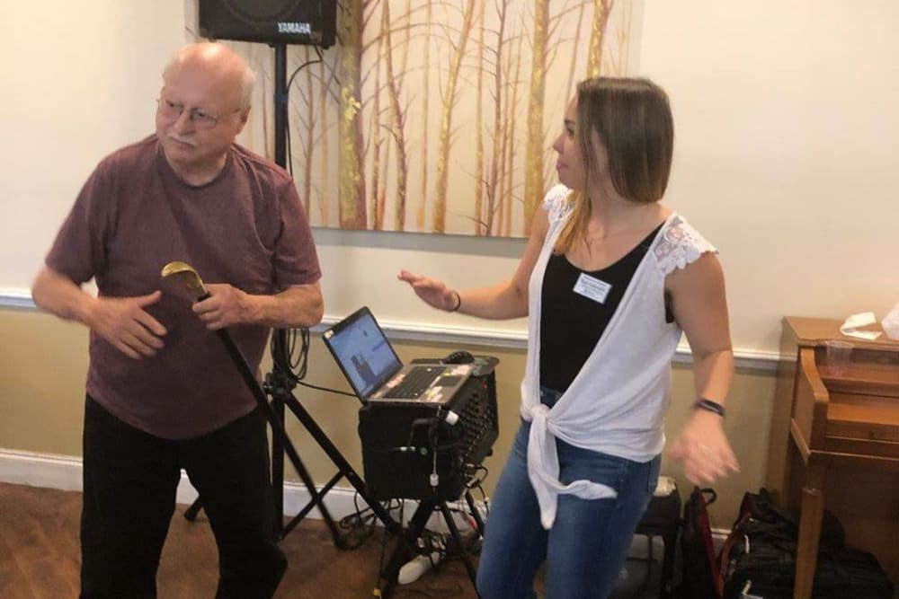 A resident and a staff member dancing together at Renaissance Retirement Center in Sanford, Florida