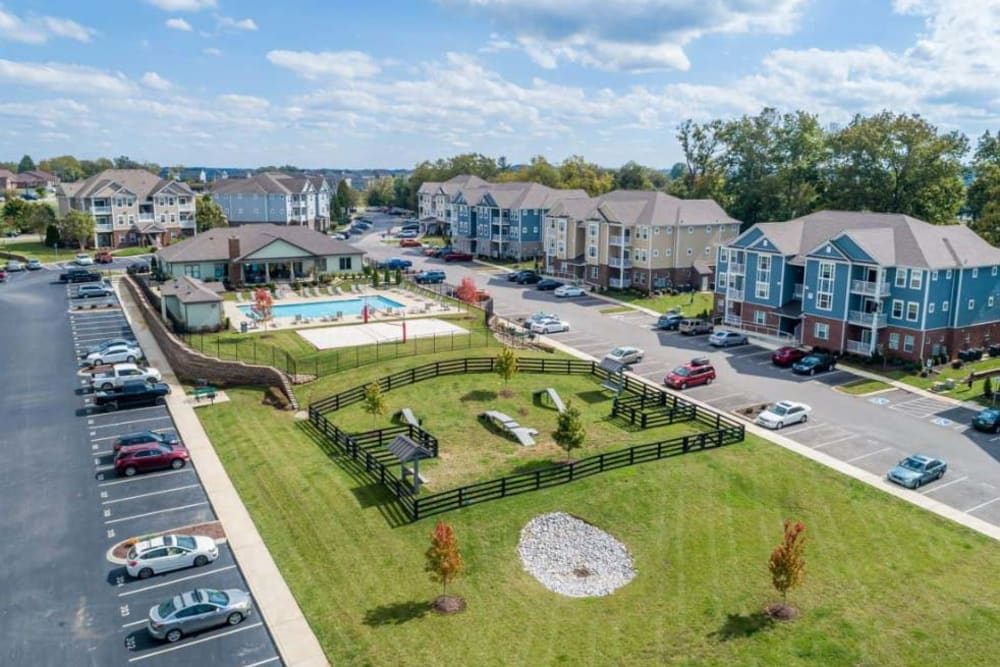 Low aerial view of the community's dog park and swimming pool area at The Retreat at Arden Village Apartments in Columbia, Tennessee