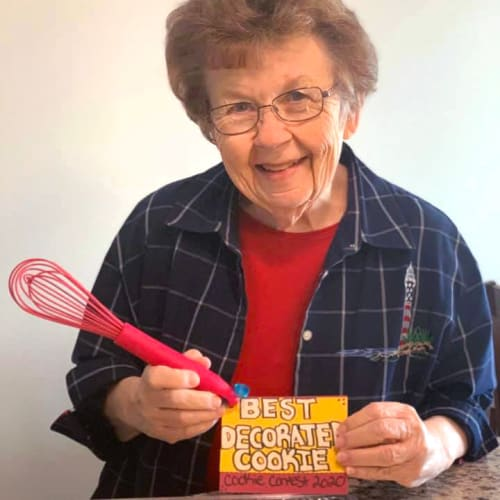 Resident with her award for best decorated cookie at Oxford Villa Active Senior Apartments in Wichita, Kansas