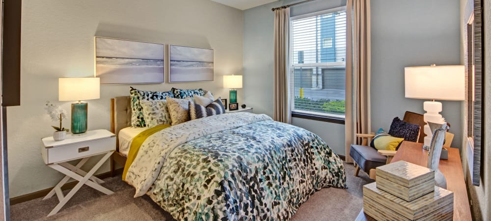 Well-lit model bedroom at The Courtney at Lake Shadow in Orlando, Florida