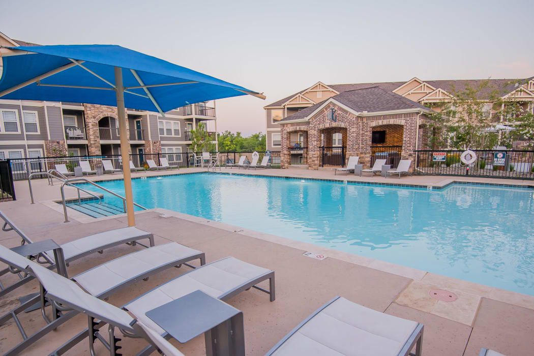 Resort style swimming pool at Cottages at Tallgrass Point Apartments in Owasso, Oklahoma