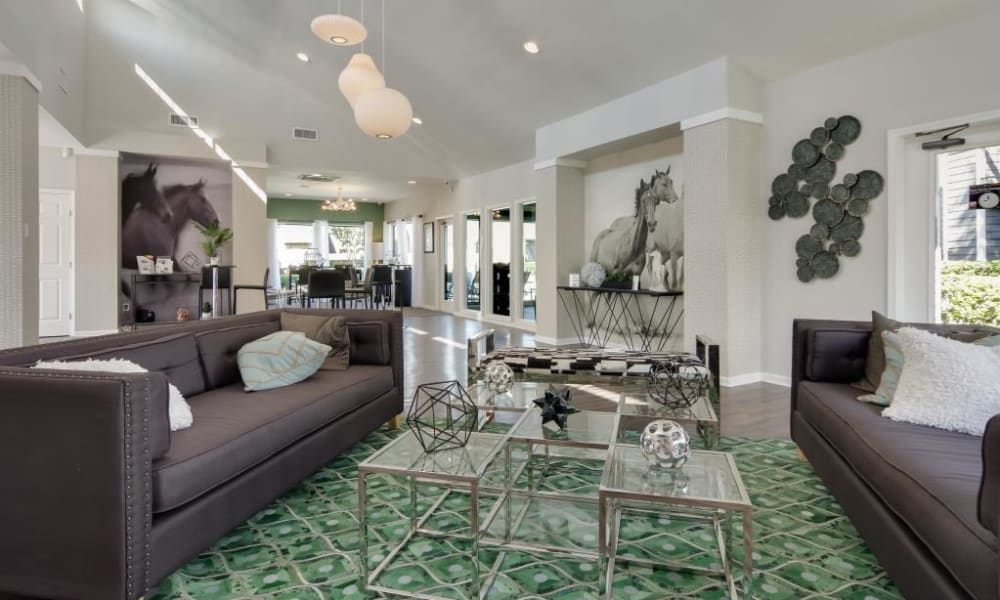 View of the resident clubhouse lounge area from the lobby entrance at The Landings at Steeplechase in Houston, Texas