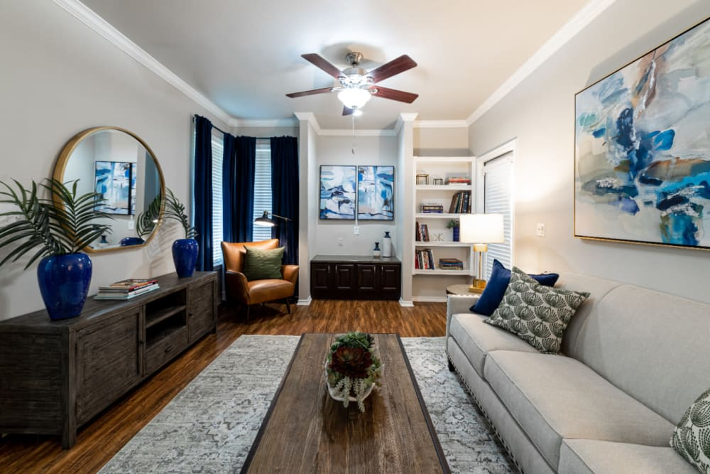 Modern style decorated living room with built-in shelves at Marquis at Bellaire Ranch in Fort Worth, Texas