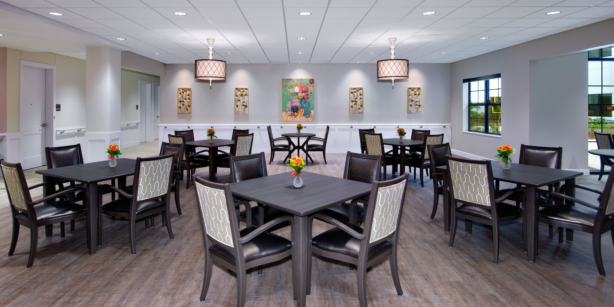 Resident dining room at Keystone Place at Naples Preserve in Naples, Florida.