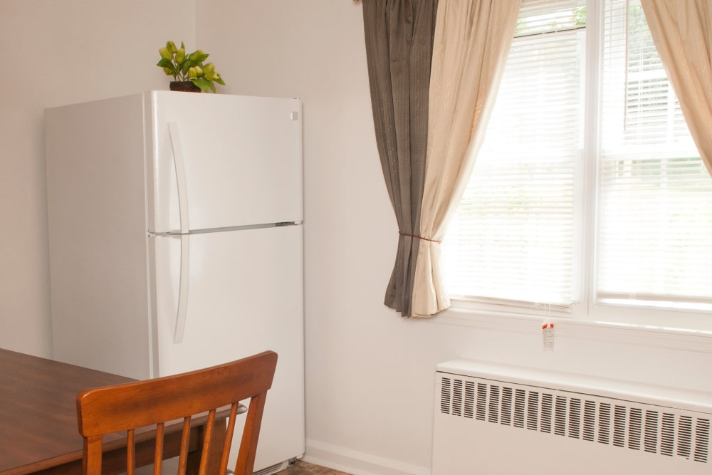 Refrigerator by the window at Oakmont Park Apartments in Scranton, Pennsylvania