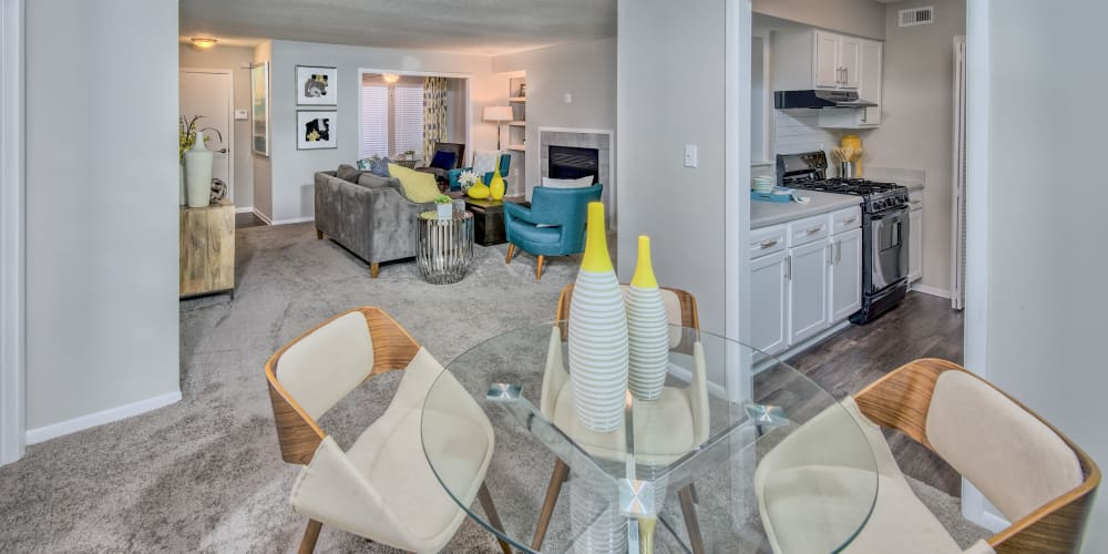 Living room and breakfast nook with modern decor at The Madison in Charlotte, North Carolina