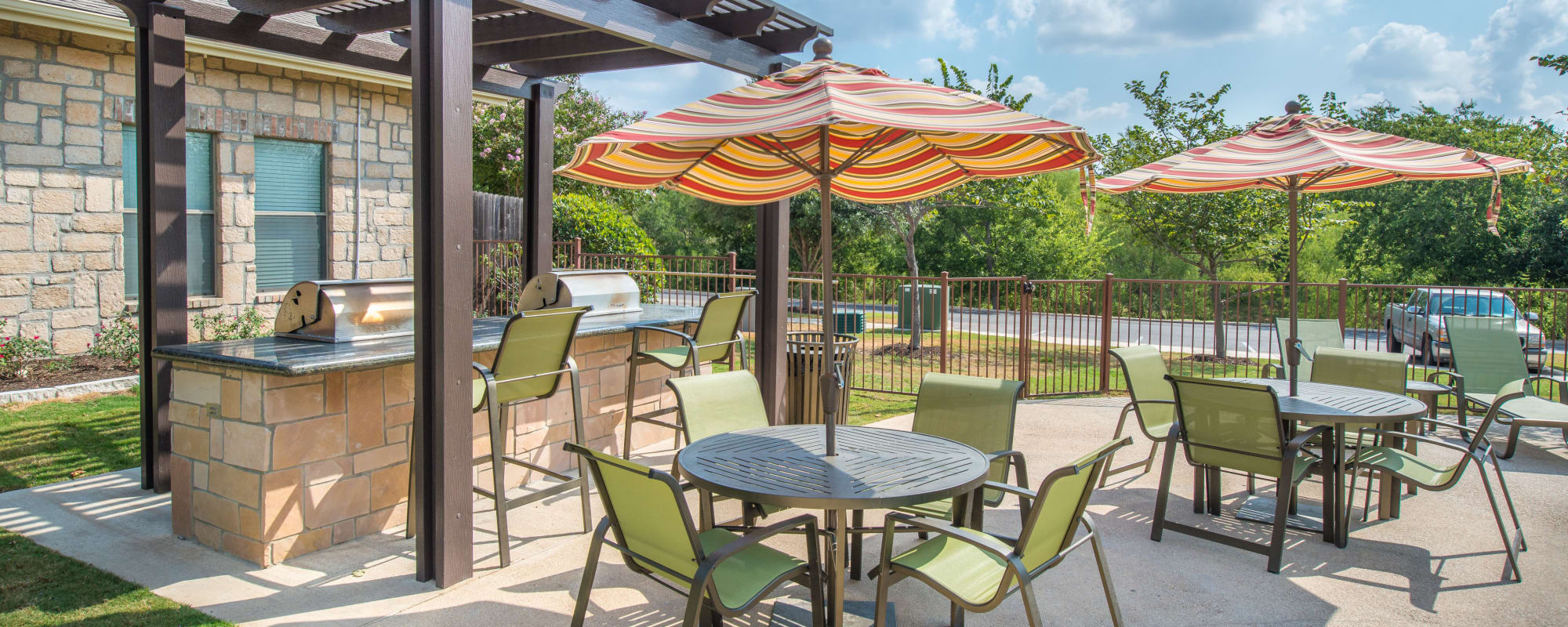 Beautiful poolside BBQ area at Arya Grove in Universal City, Texas