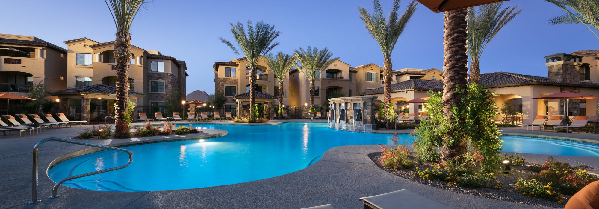 Resort-style swimming pool during the night at San Portales in Scottsdale, Arizona