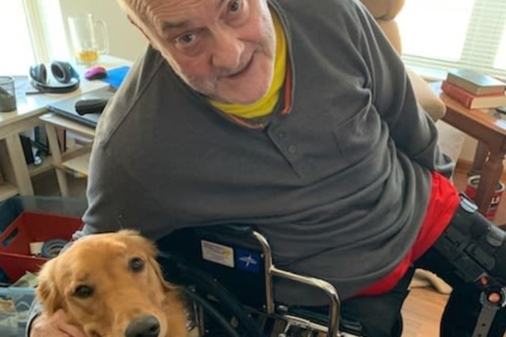 Resident and dog at Age Well Centre for Life Enrichment