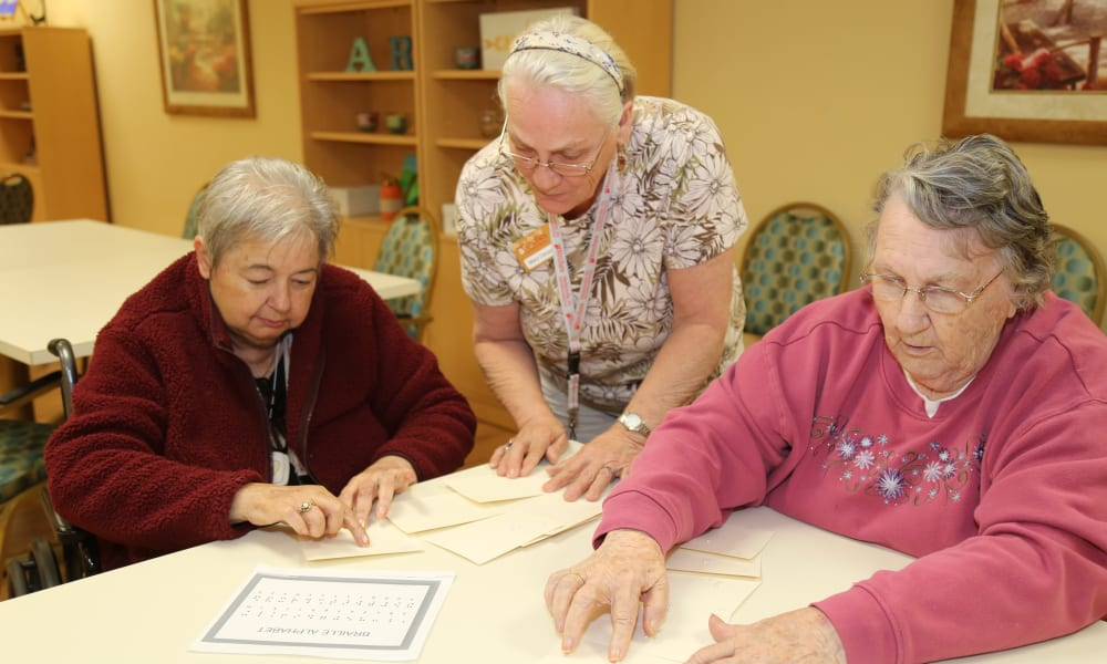 3 residents sitting at a table at The Birches at Harleysville in Harleysville, Pennsylvania