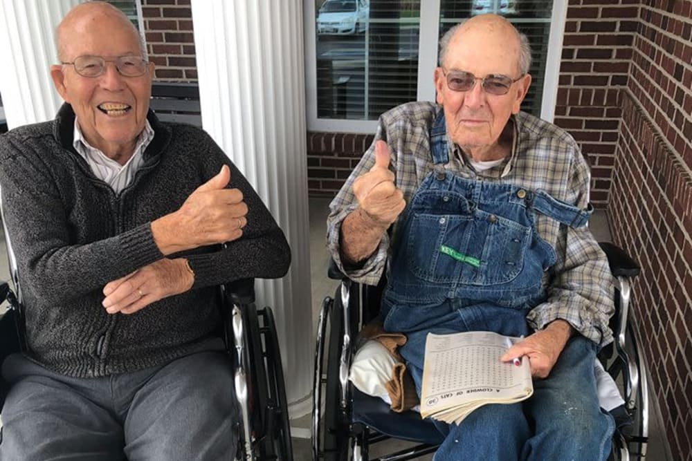 Male residents giving a thumbs up outside at The Meadows of Ottawa in Ottawa, Ohio
