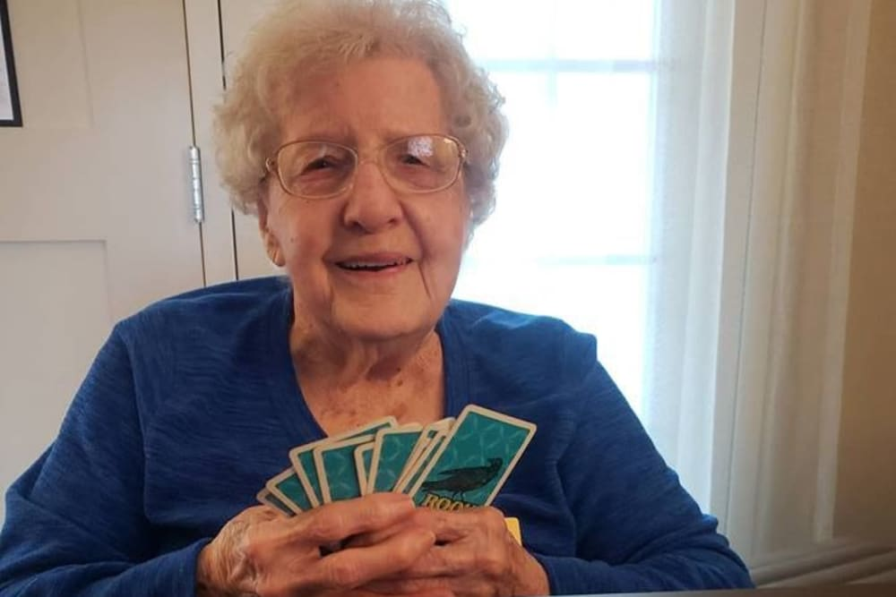 A resident playing a card game at Homewood Health Campus in Lebanon, Indiana